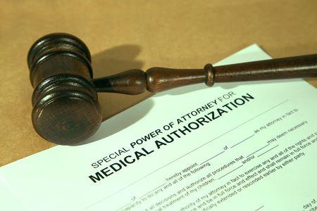 authorization: medical authorization form with gavel, shallow dof, colorful light