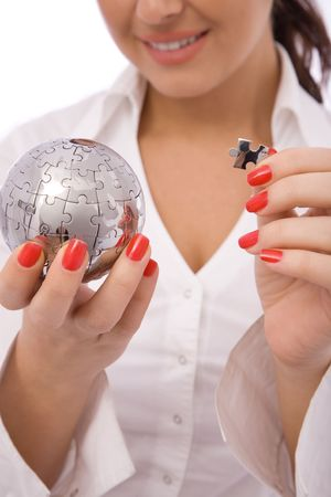 business concept with a globe puzzle and businesswoman photo