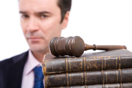 legal concept with businessman holding gavel and law books photo