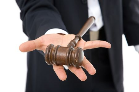 judicial: legal concept with businessman holding a gavel on white Stock Photo