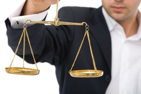 law concept in business with scales of justice and businessman
