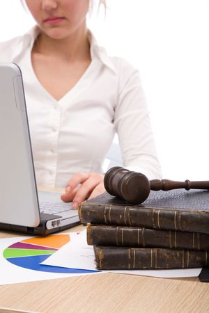 adjourned: businesswoman at the office with her laptop and gavel