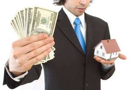 real estate finance concept with mini house and US dollars   photo