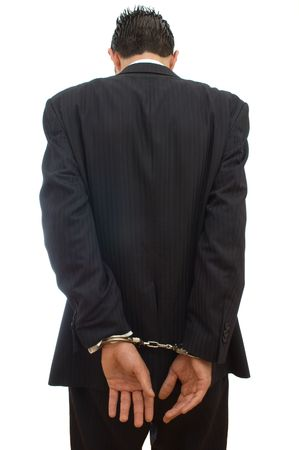 legal concept with businessman and handcuffs on white