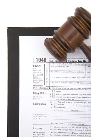 tax form: 1040 tax form with gavel on white background