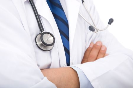 medical doctor with stethoscope on white background photo