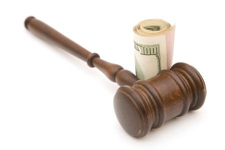 judicial proceeding: legal concept with gavel and US dollar currency on white background Stock Photo