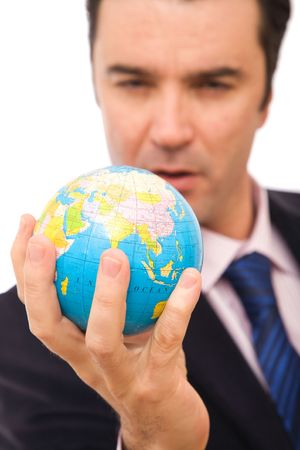 global business concept with a senior businessman holding mini globe Stock Photo - 2828552