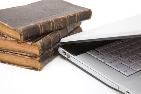 legal concept with law books and modern laptop photo