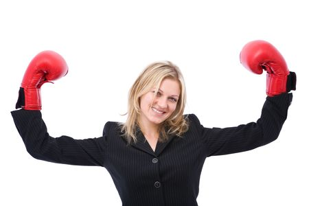 winning businesswoman portrait with boxing gloves on white