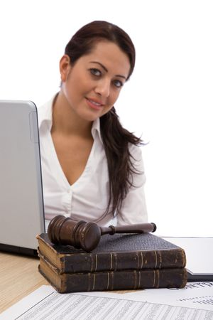 beautiful woman with old law books and gavel at the office photo