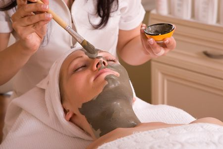 face care session at the spa center with a beautiful woman Stock Photo
