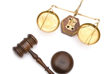 legal scales: justice concept with gavel and scales of justice on white background