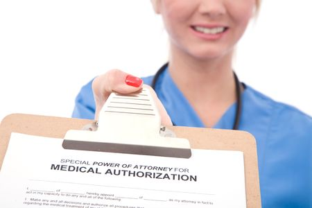 authorization: friendly female doctor with medical authorization form Stock Photo