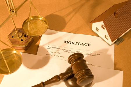real estate concept with house, gavel and mortgage document
