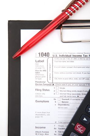 autograph: 1040 tax form with calculator and pen