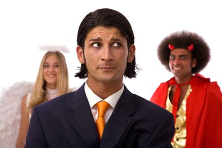 business decision concept with businessman, angel, and devil photo