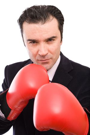 young businessman with red boxing gloves on white background