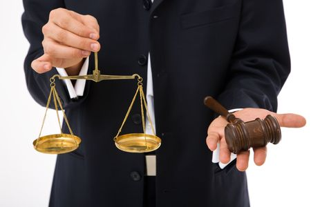 legal concept with businessman holding gavel and scales of justice photo