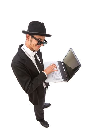 unanimous: funny looking computer hacker with laptop on white