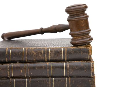 legal concept with old gavel and law books