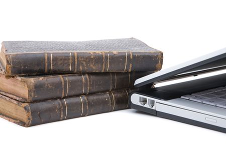 legal concept with modern laptop and old books photo