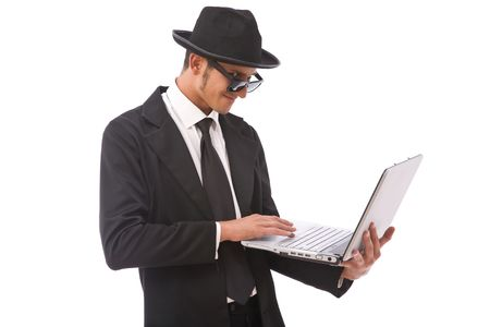 funny looking computer hacker with a laptop on white photo