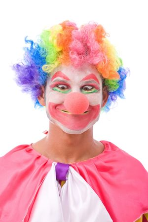 funny and colorful clown making a face on white background photo
