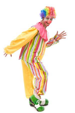 rebeldia: divertido y colorido payaso haciendo una cara en blanco Foto de archivo