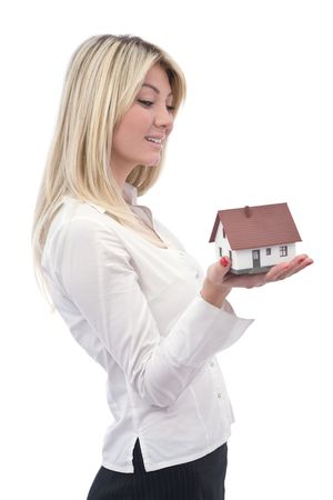investing: house investment concept in real estate with a house and businesswoman