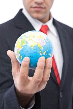 online internet presence: global business concept with a businessman holding globe