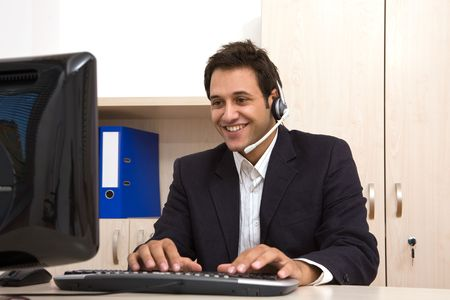 male customer service representative at the office with computer Stock Photo