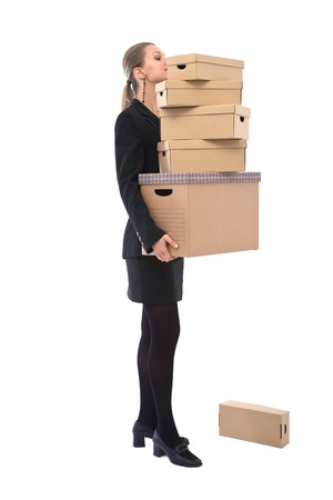 real leader: Businesswoman holding cardboard for moving house concept on white Stock Photo