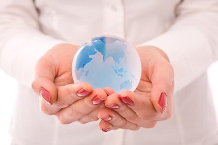 online internet presence: Globe on hands businesswoman hands Stock Photo