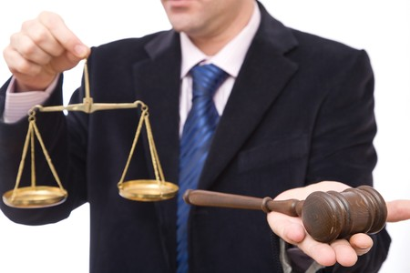 business and law concept with gavel and scales of justice photo