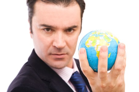 online internet presence: Serious businessman holding mini globe on white background Stock Photo