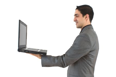 Businessman with laptop on white background photo