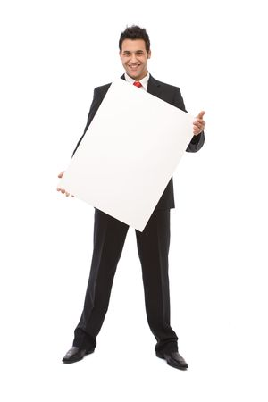 Happy businessman holding blank paper board at a presentation