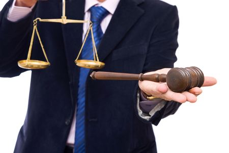 Law concept in business with businessman, gavel and scales of justice