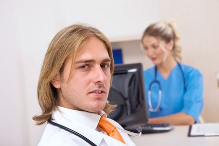 doctor and nurse work with computer in office photo