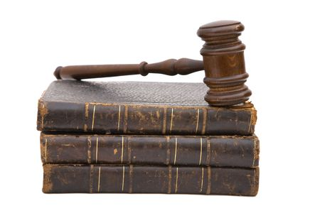 judicial proceeding: gavel and old book for legal concept on white