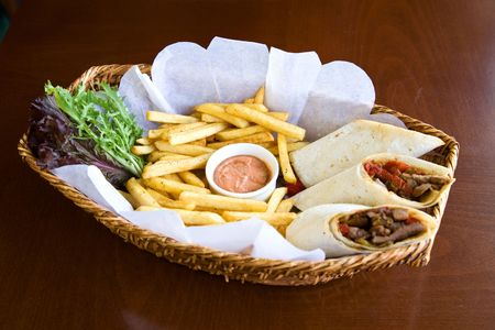 french roll: food concept with a wrap sandwich and french fries