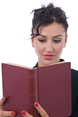 Young businesswoman reading an old law book photo