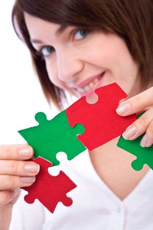 Teamwork concept with colorful puzzle pieces and business people