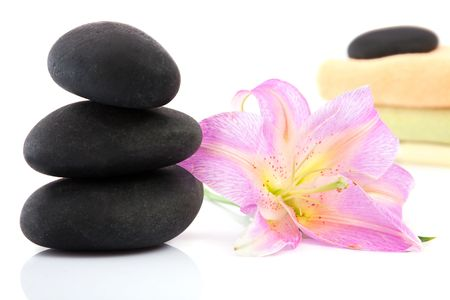 lastone: volcanic stones, lily, towels for spa and lastone concept Stock Photo