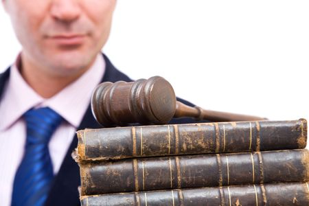 Businessman holding old law books and gavel on white background Stock Photo