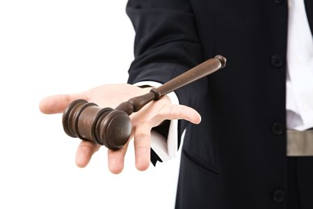 parliamentary: Businessmans hand holding wood gavel on white Stock Photo