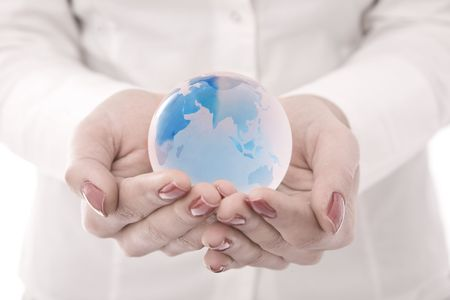 online internet presence: Globe on hands businesswoman hands Stock Photo