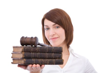 Beautiful woman with old law books and gavel at the office
