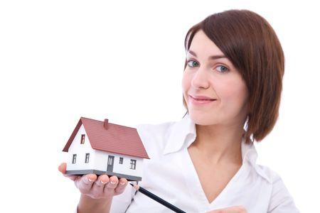 Businesswoman holding mini house on white, shallow dof